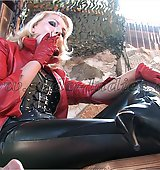 A Mistress in tight leather makes her slave serving as human ashtray.