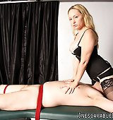 Aiden Starr tortures her slave's feet while he is in rope bondage.