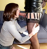 After relaxing on her bed Yvette gets her hard cock sucked by a crossdresser