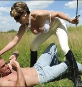 Equestrian domina outdoors trample