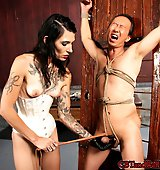 Mistress has her slave in heavy bondage while she does CBT on him