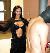 Dominatrix whipping slave