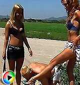 Nikki & Carmen outdoor peeing on slave